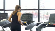 Girl working out in a treadmill at the gym video