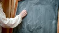 Girl writing on blackboard video