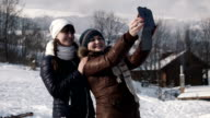 girlfriends do selfie on the mountain using tablet video