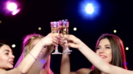 Girlfriends raise their glasses and drinking champagne at bachelorette party video