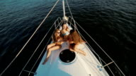 Girlfriends relaxing on a yacht. video