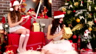 girlfriends Santa's helper lays out the name cards on Christmas gifts, empty gift box for Christmas video