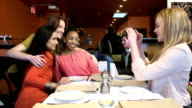 Girlfriends Take Candid Group Photo at Restaurant video