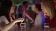 Girls at the bar talking video