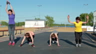 Girls doing burpee exercise, and another exercise video