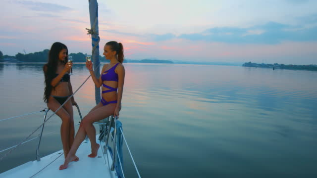 Girls drinking champagne on the yacht. video