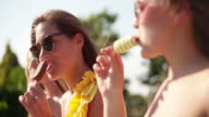 Girls eating ice cream on a summer day video