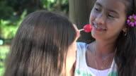 Girls Eating Lollipop Candy video