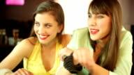 girls enjoying drinks in a restaurant video