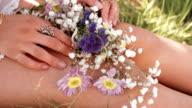 girl's hands holding flowers video