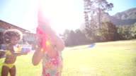 Girls having a water fight with squirt guns video