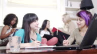 Girls having fun studying or working together video