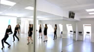 Girls in black clothes turn over to mirror one by one video