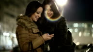 Girls in the city texting on smartphone video