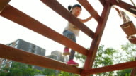 Girls is climbing plaything at playground video