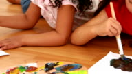 Girls lying on the floor and painting video
