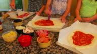 Girls making homemade  pizza's video