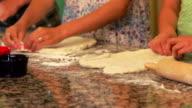 Girls making pizza dough video