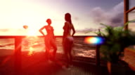 Girls on terrace chatting, seascape with air balloon and yacht sailing video