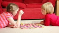 DOLLY: Girls playing board game video