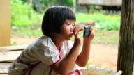 Girls playing smart phone video