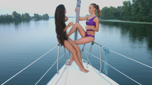 Girls relaxing on a yacht. video