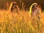 PAL Girls run through tall grass video