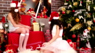 girls Santa's helper wrapping gifts video