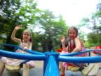 Girls spinning on merry go round video