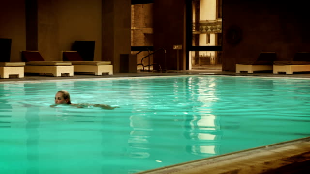 Girl's swimming in the pool at the wellness center video