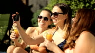 girls taking photo by the pool video