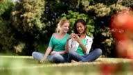 girls taking photo video