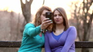 Girls taking selfie with mobile phone video