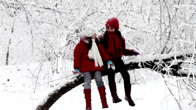 Girls talking on a tree video