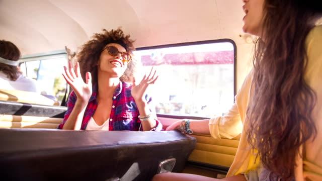 Girls talking on road trip video