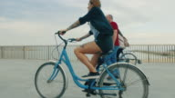 Girls together ride bicycles in the city video