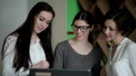 Girls view something on laptop video
