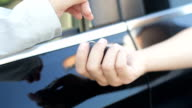 Giving car keys, close up video