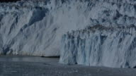 Glacier calving with ice dust waterfall video