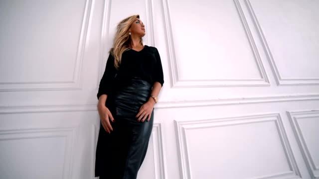 Glamour fashion business style beautiful woman posing in modern studio video