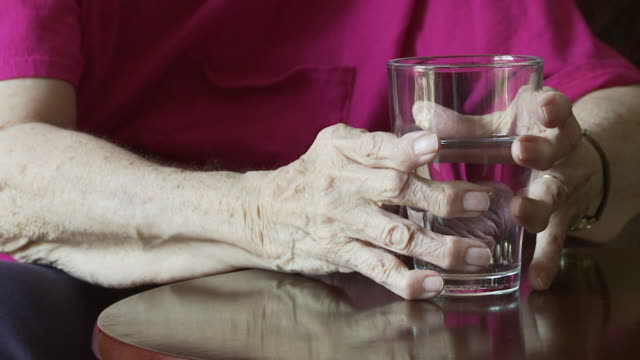 Glass and Arthritic Hands Slo-mo video