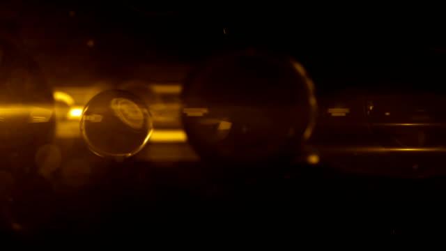 Glass Balls Fluoro Light Reflection Background Loop - Gold Glow video