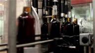 Glass bottles on a belt conveyor video