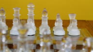 Glass Chess Pieces Set Up On Board video