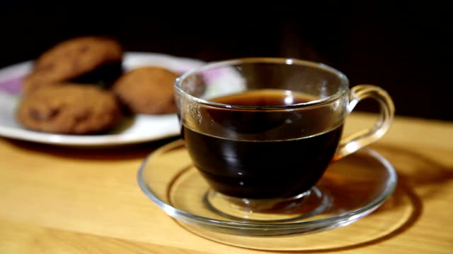 glass cup with coffee and biscuits on a plate video