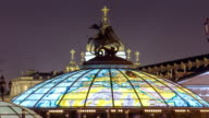 Glass cupola crowned by a statue of Saint George, patron of Moscow, at the Manege Square timelapse in Moscow, Russia video