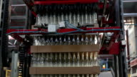 Glass factory. Machine for piling up bottles. video