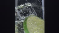 glass, ice, lemon and tonic video