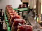 Glass jar with beetroot on conveyor line video