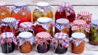 Glass jars with canned food. video